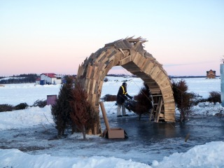 The Ouroboros getting ready to be burned along with re-cycled Christmas trees ! 2015 Long John Jamboree Note the boat houses in the background frozen into the ice.