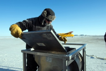 Mr. Al Tremblay from the Defence Research Development Canada (Atlantic) checks on the ice drill equipment to make sure it is ready to deploy to the ice dive site during Operation NUNALIVUT on April 9, 2015. Photo: MS Peter Reed, Formation Imaging Services, Halifax