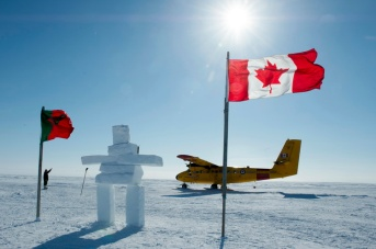 A CC-138 Twin Otter drops off a generator and other gear at the site of HMS Erebus from the Sir Franklin expedition during Operation NUNALIVUT on April 9, 2015. Photo: MS Peter Reed, Formation Imaging Services, Halifax