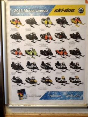A vast selection of snowmobiles for sale through the local store