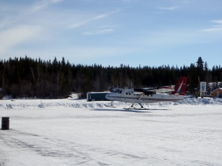 An Air Tindi Havilland Canada DHC-6 Twin Otter landing on the ice