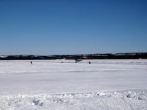 An Air Tindi Havilland Canada DHC-6 Twin Otter taxiing on the ice runway